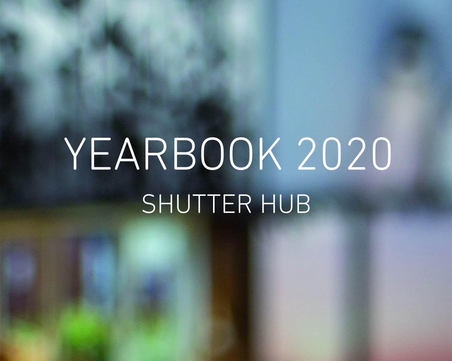 Text ready 'YEARBOOK 2020, SHUTTER HUB' on a background of an out of focus photograph of a screen showing an online exhibition.