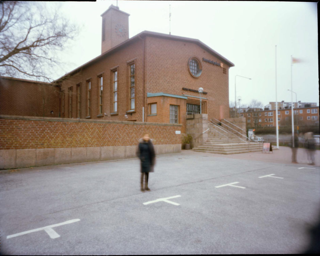An image of an out of focus female refugee outside of the Swedish Church in Malmo, Sweden.