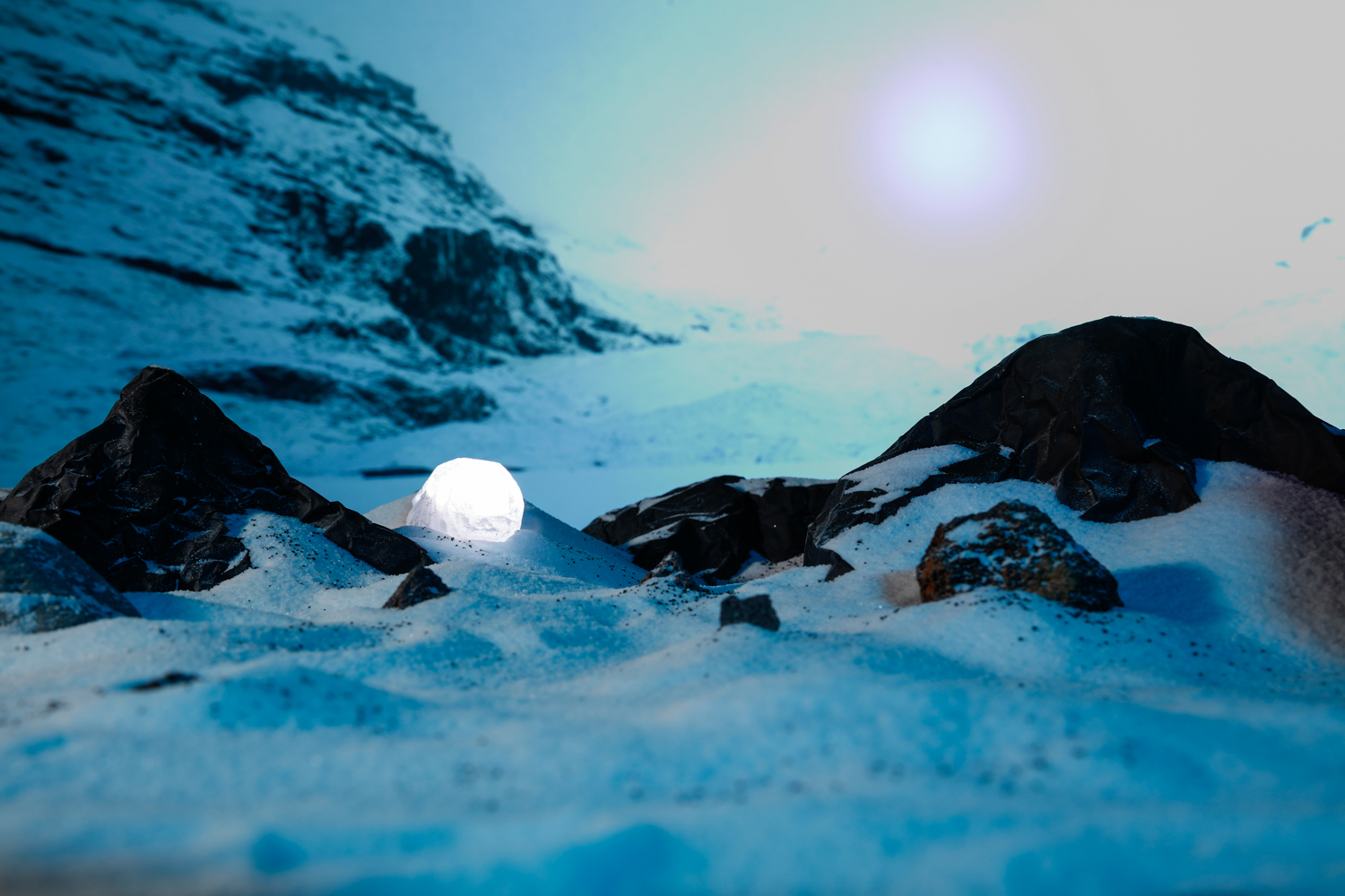 Photograph of an other-worldy snowy scene with glowing orbs