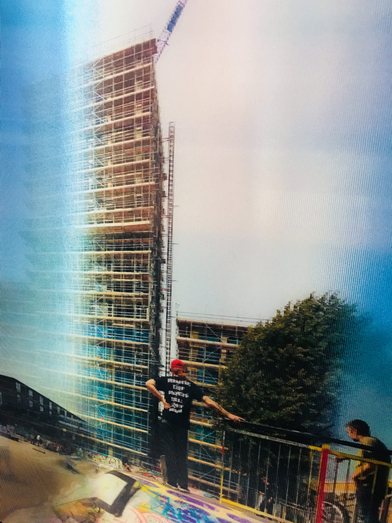 Photograph of lenticular print of tower block construction in South London