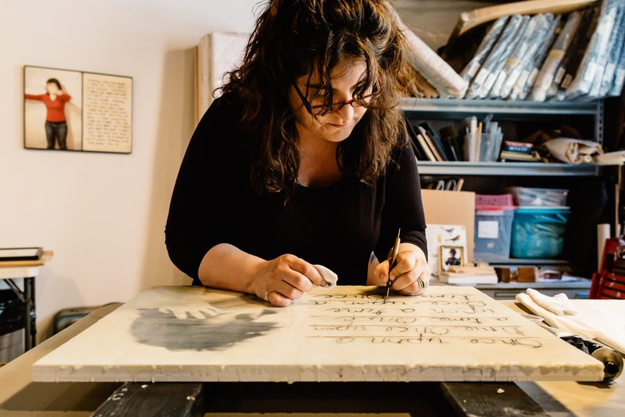 Photograph of Jessica Burko at work in her studio