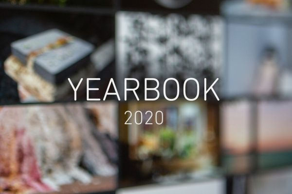 Image of a screen showing an online photography exhibition, very soft focus, with text in the middle reading 'YEARBOOK 2020'