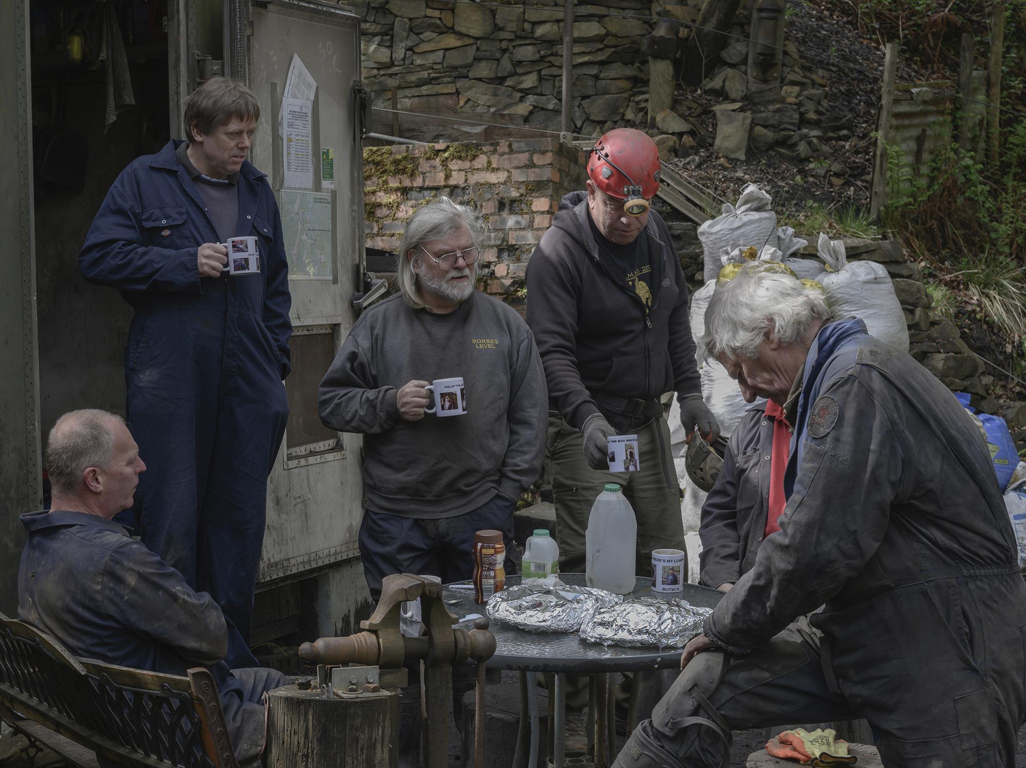 Miners drinking tea before going underground