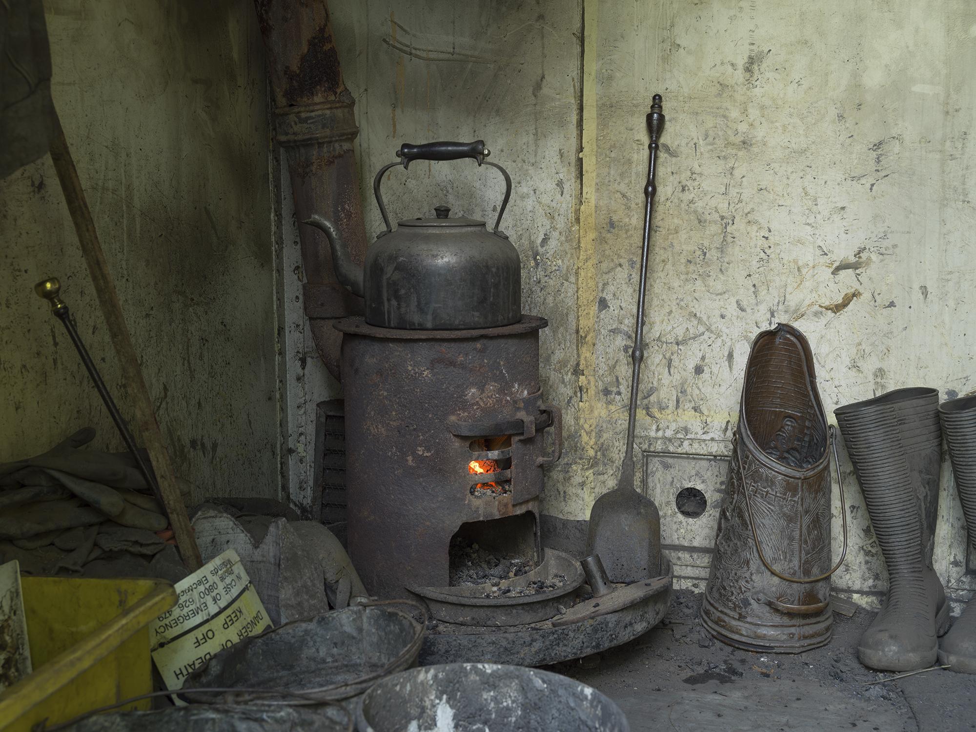 Kettle on stove in mining hut